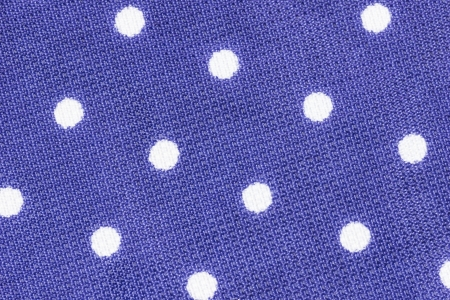 Close up shot of violet polka dot seamless fabric texture photo