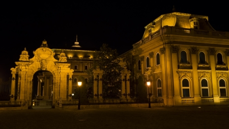 obuda: Budapest, ornate arched gateway to the Buda Castle Or Royal Palace at night Editorial
