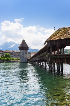 Famous wooden Chapel Bridge in Luzern, Switzerland photo