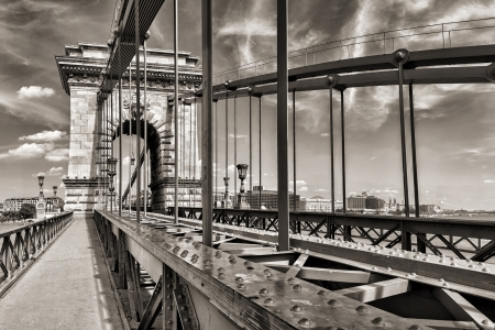 bridge footing: Hungarian landmark, Budapest Chain Bridge day monochrome view