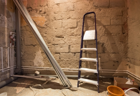 junction pipe: process of repair of bathroom (pipes, bricks and steps)