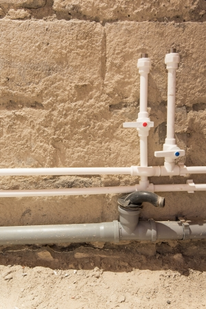 isolators: process of repair of bathroom (pipes, isolators and sewer) Stock Photo