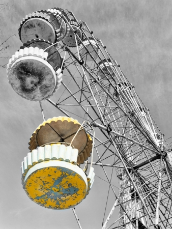 Yellow cabin of the abandoned Ferris wheel, Pervouralsk, Urals, Russia photo