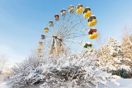 Winter panorama of abandoned Ferris wheel, Pervouralsk, Urals, Russia