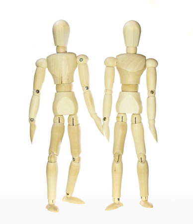 dummies: Wooden dummies -friendship (isolated on white background) Stock Photo