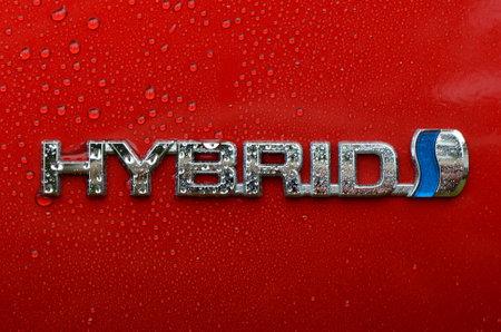 Toyota Prius 4 - emblem - Berlin, Germany - 09082017 - Emblem of HYBRID on a ecofriendly car