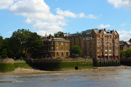 View to the shore development of the Thames at low water with the Olivers Wharf in the Tudor gothic style - London, Great Britain - 08042015 Editorial