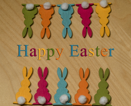 Ten colorful wooden Easter bunnies opposite in two rows - Easter greetings in English
