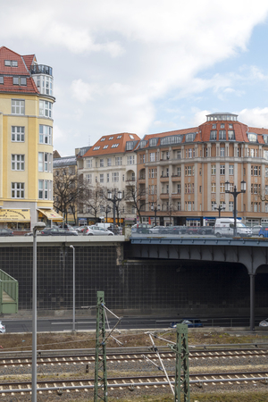 Highway and railroad lines leading under bridges in front of apartment blocks - Berlin, Germany - 02042018