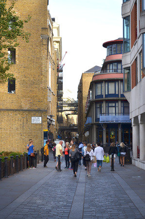 View to the historic walkway through the Shad Thames with brick buildings in Bermondsey - London, Great Britain - 08012015