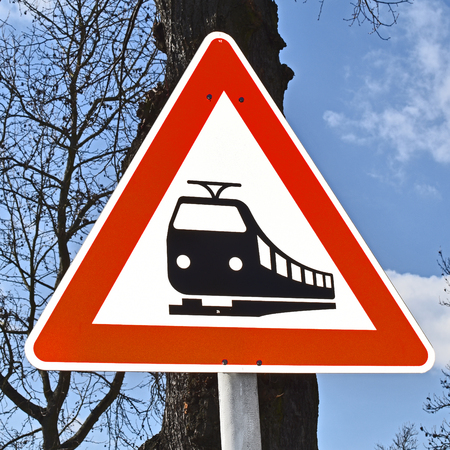 Close-up of a traffic sign in Berlin, Germany, which indicates a nearby railway crossing