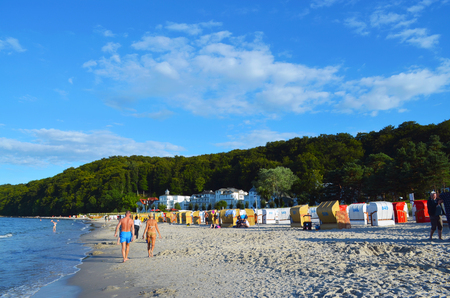Binz on Ruegen, Germany - August 19, 2016: Beachlife: Spa visitors with sand, sun, beach chairs and blue sky on the island Ruegen Editorial