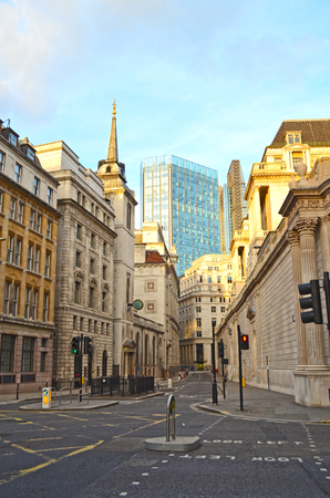 View of Lothbury Street in London Banking District, overlooking a skyscraper and St. Margarets Church on the left. 写真素材