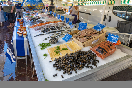 Nice, France - October 5, 2018: View of a market stall in Nice with fish and other seafood.