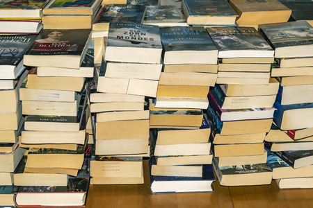 Berlin, Germany - October 22, 2018: Many used and stacked German books that were sorted out after reading. Editorial