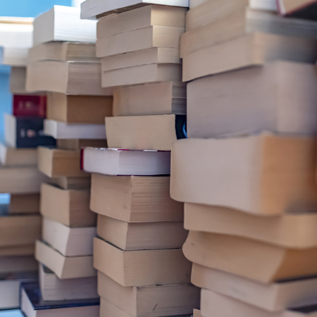Many used and stacked books that were sorted out after reading.