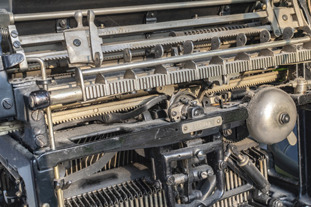 Detail of a historic dusty mechanical typewriter made in Germany during the twenties of the 20th century.