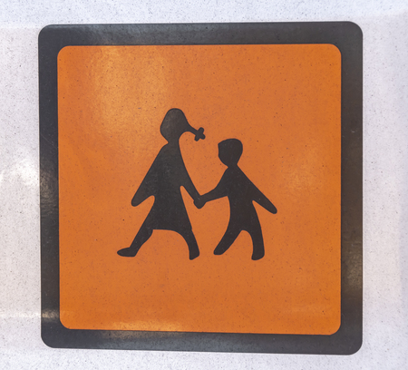 Close-up of a sign on a school bus for children in Germany.