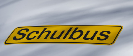 Close-up of a sign on a school bus in Germany. Translation: German for school bus.