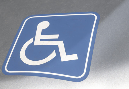 Close-up of a sign on a car for handicapped people in Germany.