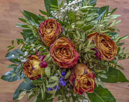 Close-up of a bouquet of dried roses and various complementary plants. Reklamní fotografie