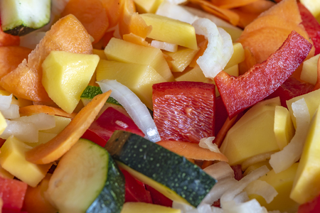 Raw fresh vegetables cut and mixed for further processing.