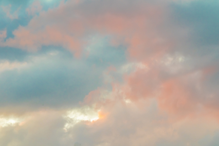 Clouds in the sky, which are beautifully illuminated by the evening sun and invite you to dream and relax.