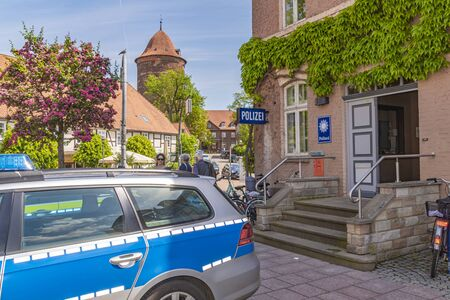Dannenberg, Germany - May 23, 2019: A German police car parked in front of the police station of a medieval city. Redactioneel