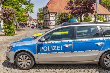 Dannenberg, Germany - May 23, 2019: Two German police cars parked at the roadside of a medieval town.