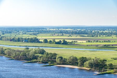 View over the Elbauen in Lower Saxony, Germany. You see a landscape with fields, meadows and the river Elbe.