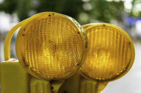 Close up view of two orange warning lights on a construction site. Stok Fotoğraf