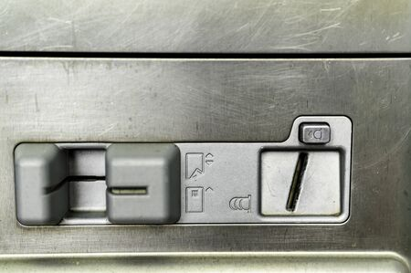 Close-up of a slot machine for coins and for card payment. Imagens