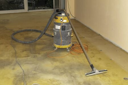Industrial vacuum cleaner to clean the floor after it has been sanded.