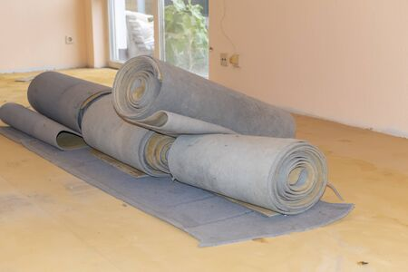 Carpet leftovers in a living room after being removed to lay a new floor covering. Stok Fotoğraf