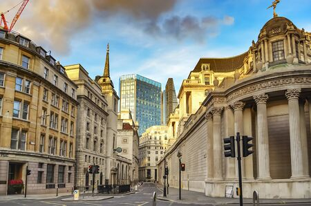 View of Lothbury Street in London Banking District, overlooking a skyscraper and St. Margarets Church on the left. Stok Fotoğraf