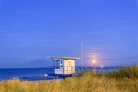 Moonrise at the seaside from Usedom, Germany. In the foreground you can see the lifeguard's cottage.