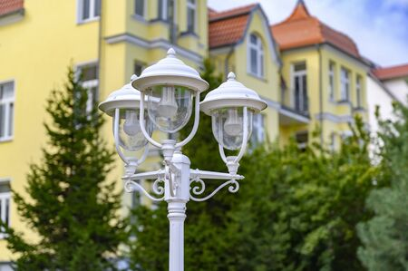 A three-armed lantern in front of a house in Bansin on the island Usedom, Germany. Фото со стока