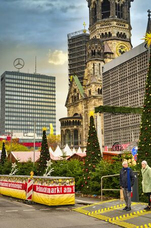 Berlin, Germany - November 22, 2019: Measures to protect against a terrorist attack on the Christmas market next to the historic Kaiser Wilhelm Memorial Church, as it took place on December 19, 2016.