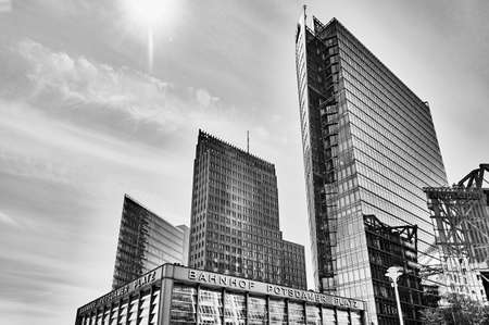 Berlin, Germany - May 8, 2020: Black and white photo of the historic Potsdamer Platz in Berlin with the train station in the foreground and the modern high-rise buildings in the background. Editorial