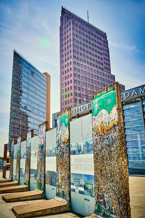 Berlin, Germany - May 8, 2020: The historic Potsdamer Platz in Berlin with parts of the Berlin Wall in the foreground and the modern high-rise buildings in the background. Standard-Bild - 146908963