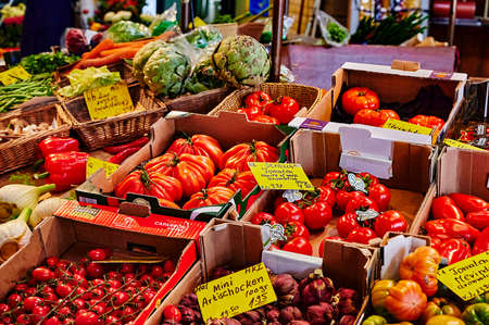 Berlin, Germany - May 13, 2020: A market stall with various colorful varieties of vegetables.
