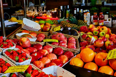 Berlin, Germany - May 13, 2020: A market stall with various colorful varieties of fruits. Editorial