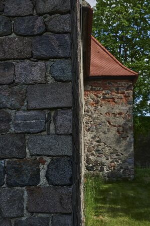 Details of the masonry of a medieval village church in the state of Brandenburg, Germany. The focus lies on the left front wall. Standard-Bild