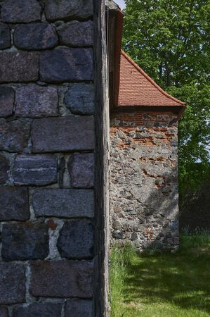 Details of the masonry of a medieval village church in the state of Brandenburg, Germany. The focus lies on the right wall in the background. Standard-Bild - 147784207