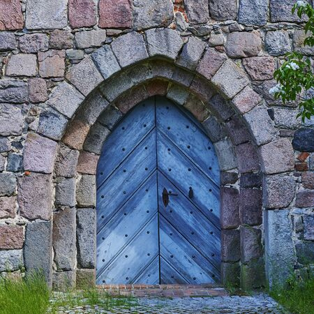 View to the entrance of a medieval village church in the state of Brandenburg, Germany. Standard-Bild - 147784228
