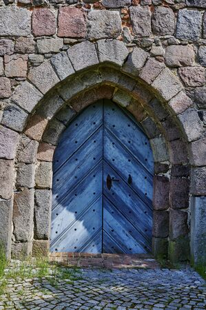 View to the entrance of a medieval village church in the state of Brandenburg, Germany. Standard-Bild