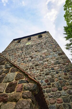 Details of a historic medieval church in Berlin, Germany. You can see the church tower from a low angle shot.