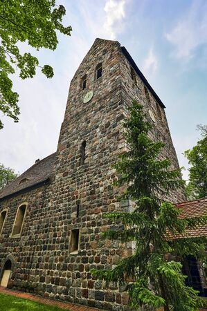 Details of a historic medieval church in Berlin, Germany. You can see parts of the building with the church tower.