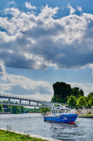 Berlin, Germany - June 14, 2020: A ship of the Berlin water police on the river Spree in the government district of the German capital.