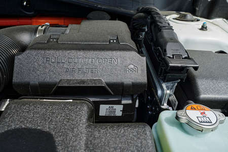 Berlin, Germany - June 24, 2020: A look into the engine compartment of a plug-in hybrid car with various components. Editorial